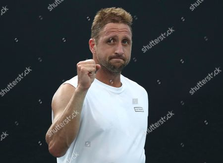 Tennys Sandgren of the U.S. reacts after defeating compatriot Sam Querrey in their third round singles match at the Australian Open tennis championship in Melbourne, Australia