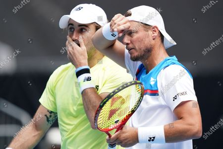 Lleyton Hewitt (R) and Jordan Thompson of Australia during their first round doubles match against Ji Sung Nam and Min-Kyu Song of Korea on day five of the Australian Open tennis tournament at Melbourne Park in Melbourne, Australia, 24 January 2020.