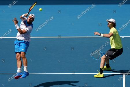 Lleyton Hewitt (L) and Jordan Thompson of Australia during their first round doubles match against Ji Sung Nam and Min-Kyu Song of Korea on day five of the Australian Open tennis tournament at Melbourne Park in Melbourne, Australia, 24 January 2020.