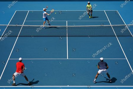 Lleyton Hewitt (L, top) and Jordan Thompson of Australia in action during their first round doubles match against Ji Sung Nam (L, bottom) and Min-Kyu Song of Korea on day five of the Australian Open tennis tournament at Melbourne Park in Melbourne, Australia, 24 January 2020.
