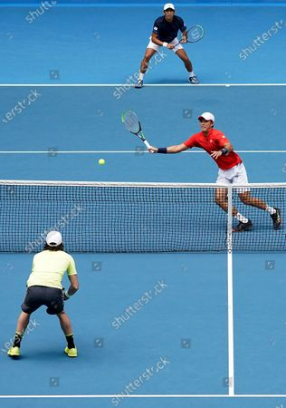 Ji Sung Nam (R) and Min-Kyu Song (C, top) of Korea during their first round doubles match against Jordan Thompson (L) and Lleyton Hewitt of Australia on day five of the Australian Open tennis tournament at Melbourne Park in Melbourne, Australia, 24 January 2020.