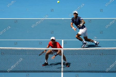 Ji Sung Nam (L) and Min-Kyu Song of Korea during their first round doubles match against Jordan Thompson and Lleyton Hewitt of Australia on day five of the Australian Open tennis tournament at Melbourne Park in Melbourne, Australia, 24 January 2020.