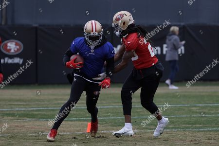 San Francisco 49ers strong safety Jaquiski Tartt, left, and cornerback Richard Sherman practice at the team's NFL football training facility in Santa Clara, Calif., . The 49ers will face the Kansas City Chiefs in Super Bowl 54