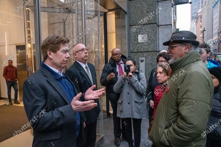 Stock Photo of Ravi Ragbir, Executive Director of The New Sanctuary Coalition, speaks to a representative of building management housing Amazon's 34th Street offices in a unsuccessful attempt to speak with an Amazon representative.