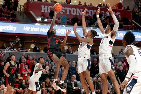 Houston guard DeJon Jarreau (3) puts up a shot past, from left, Connecticut guard Christian Vital, guard Brendan Adams, forward Isaiah Whaley and forward Sidney Wilson (15) during the second half of an NCAA college basketball game, in Houston