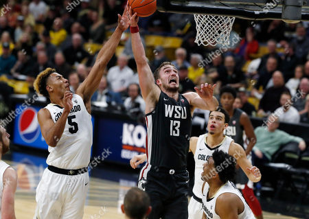R m. Washington State forward Jeff Pollard, center, goes up for a basket between Colorado guard D'Shawn Schwartz, left, and forward Evan Battey in the first half of an NCAA college basketball game, in Boulder, Colo