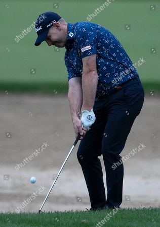 Stock Image of Stephen Gallacher of Scotland plays a shot on the 10th dirt during the second round of the Dubai Desert Classic golf tournament in Dubai, United Arab Emirates