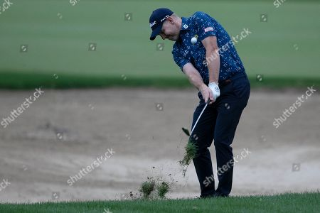 Stephen Gallacher of Scotland plays a shot on the 10th dirt during the second round of the Dubai Desert Classic golf tournament in Dubai, United Arab Emirates