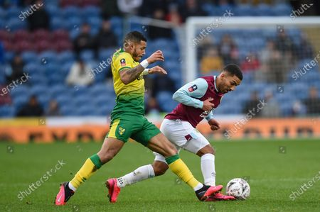 25th January 2020, Turf Moor, Burnley, England; Emirates FA Cup, Burnley v Norwich City : Onel Hernandez (11) of Norwich City fouls Aaron Lennon (25) of Burnley
