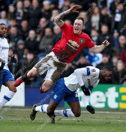 Corey Blackett-Taylor of Tranmere Rovers fouls Phil Jones of Manchester United