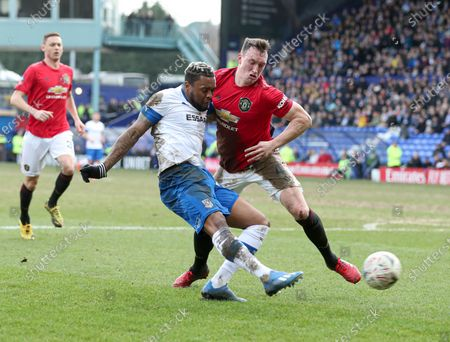 Phil Jones of Manchester United and Morgan Ferrier of Tranmere Rovers