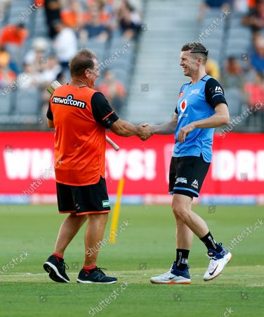 24th January 2020; Optus Stadium, Perth, Western Australia, Australia; Big Bash League Cricket, Perth Scorchers versus Adelaide Stikers; Former Australian players Peter Siddle and Geoff Marsh greet each other in the middle