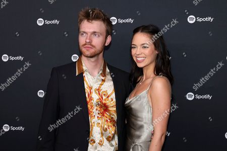 Finneas O'Connell, Claudia Sulewski. Finneas O'Connell, left, and Claudia Sulewski arrive at the 2020 Spotify Best New Artist Party at The Lot Studios, in West Hollywood, Calif