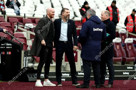 Stock Photo of 25th January 2020; London Stadium, London, England; English FA Cup Football, West Ham United versus West Bromwich Albion; West Bromwich Albion Manager Slaven Bilic speaks with former West Ham United player James Collins