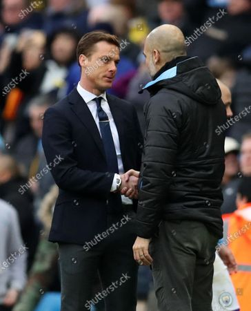 26th January 2020; Etihad Stadium, Manchester, Lancashire, England; English FA Cup Football, Manchester City versus Fulham; Fulham manager Scott Parker shakes hands with Manchester City manager Pep Guardiola at the final whistle - Strictly Editorial Use Only. No use with unauthorized audio, video, data, fixture lists, club/league logos or 'live' services. Online in-match use limited to 120 images, no video emulation. No use in betting, games or single club/league/player publications
