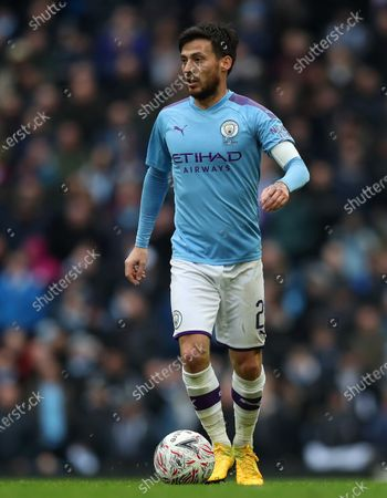 26th January 2020; Etihad Stadium, Manchester, Lancashire, England; English FA Cup Football, Manchester City versus Fulham; David Silva of Manchester City holds the ball up as he looks for an outlet - Strictly Editorial Use Only. No use with unauthorized audio, video, data, fixture lists, club/league logos or 'live' services. Online in-match use limited to 120 images, no video emulation. No use in betting, games or single club/league/player publications