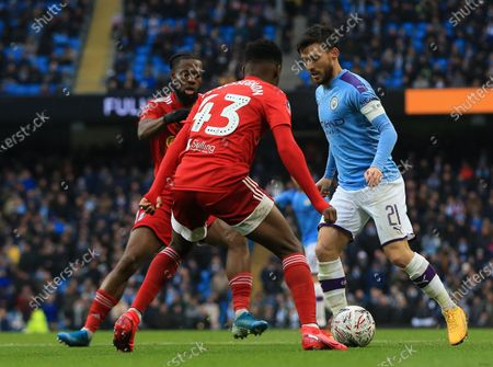 Stock Picture of 26th January 2020; Etihad Stadium, Manchester, Lancashire, England; English FA Cup Football, Manchester City versus Fulham; David Silva of Manchester City takes on Steven Sessegnon of Fulham