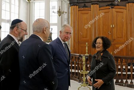 (L to R) Israel Museum Chairman Issac Molcho, British Chief Rabbi Ephraim Mirvis and Britain's Prince Charles, visit the 1736 Suriname reconstructed Tzedek ve-Shalom Synagogue at the Israel Museum in Jerusalem