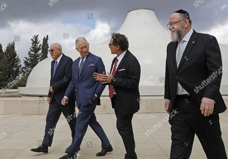 (L to R) Israel Museum Chairman Issac Molcho, Britain's Prince Charles, Curator of the Shrine of the Book Adolfo Roitman, and British Chief Rabbi Ephraim Mirvis walk outside the 1736 Suriname reconstructed Tzedek ve-Shalom Synagogue at the Israel Museum in Jerusalem