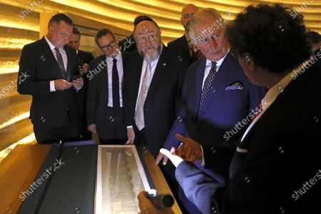 Britain's Prince Charles (C) alongside British Chief Rabbi Ephraim Mirvis listen to Curator of the Shrine of the Book Adolfo Roitman (R) during a visit to the Shrine of the Book at the Israel Museum in Jerusalem