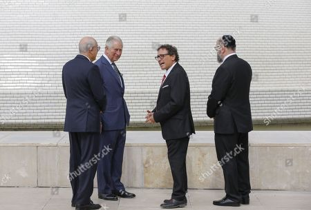 (L to R) Israel Museum Chairman Isaac Molcho, Britain's Prince Charles, Curator of the Shrine of the Book Adolfo Roitman, and British Chief Rabbi Ephraim Mirvis visit the Shrine of the Book at the Israel Museum in Jerusalem