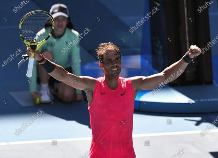 Stock Picture of Rafael Nadal celebrates victory after his Men's Singles Third Round match against Pablo Carreno Busta