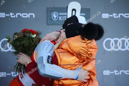 Stock Picture of Norway's Kjetil Jansrud, left, celebrates on the podium with former ski star United States' Lindsey Vonn after winning an alpine ski, men's World Cup super G, in Kitzbuehel, Austria