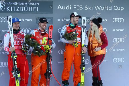 Norway's Kjetil Jansrud, second from right, winner of the alpine ski, men's World Cup super G, celebrates on the podium with former ski star United States' Lindsey Vonn, right, second placed Norway's Aleksander Aamodt Kilde, second from left, and third placed Austria's Matthias Mayer, in Kitzbuehel, Austria