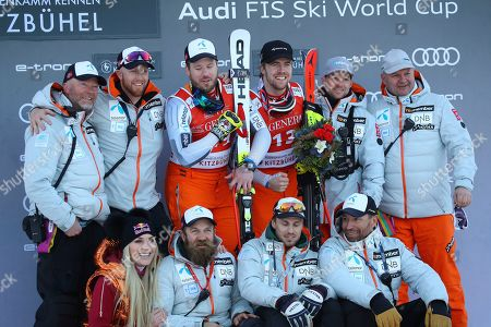 Norway's Kjetil Jansrud, third from left, winner of the alpine ski, men's World Cup super G, celebrates on the podium with second placed Norway's Aleksander Aamodt Kilde, third from right, their team and former ski star United States' Lindsey Vonn, bottom left, in Kitzbuehel, Austria