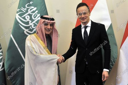Saudi Minister of State for Foreign Affairs Adel al-Jubeir (L) and Hungarian Minister of Foreign Affairs and Trade Peter Szijjarto shake hands during their meeting in the latter's office in Budapest, Hungary, 24 January 2020.