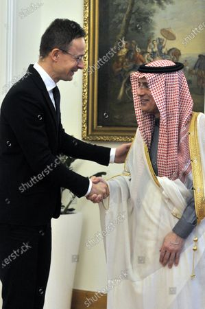 Saudi Minister of State for Foreign Affairs Adel al-Jubeir (R) and Hungarian Minister of Foreign Affairs and Trade Peter Szijjarto shake hands during their meeting in the latter's office in Budapest, Hungary, 24 January 2020.