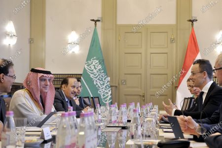 Saudi Minister of State for Foreign Affairs Adel al-Jubeir (2-L) and Hungarian Minister of Foreign Affairs and Trade Peter Szijjarto (R) sit at the conference table during their meeting in the latter's office in Budapest, Hungary, 24 January 2020.