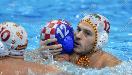 Alejandro Bustos (R) of Spain and Javier Garcia (C) of Croatia react during the men's European Water Polo Championship semi final match between Croatia and Spain in Budapest, Hungary, 24 January 2020.