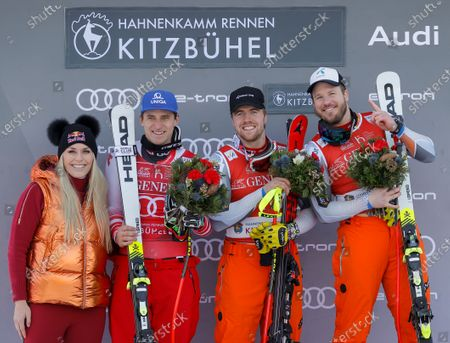 US former alpine ski racer Lindsey Vonn (L) poses on the podium with winner Kjetil Jansrud of Norway (R) joined by third placed Mathias Mayer of Austria (2-L) and second placed Aleksander Aamodt of Norway (2-R) after the men's Super G race of the FIS Alpine Skiing World Cup event in Kitzbuehel, Austria, 24 January 2020.