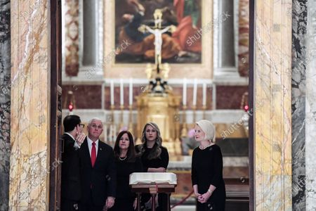 US Vice President Mike Pence (2-L), his wife Karen (C-L), his daughter in law Sarah (C-R) and US Ambassador to the Holy See, Callista Gingrich (R), during a cultural visit in the Regia room at the Vatican, 24 January 2020.