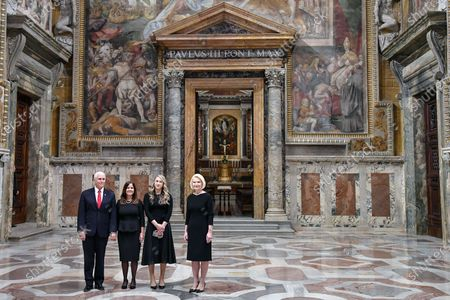 US Vice President Mike Pence (L), his wife Karen (C-L), his daughter in law Sarah (C-R) and US Ambassador to the Holy See, Callista Gingrich (R), during a cultural visit in the Regia room at the Vatican, 24 January 2020.
