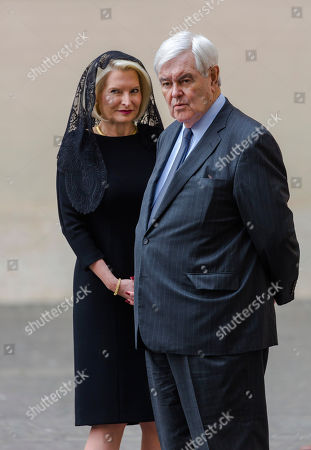 U.S ambassador to the Holy See, Callista Gingrich, left, and her husband, former U.S. House Speaker Newt Gingrich wait for the arrival of U.S. Vice-President Mike Pence at the Vatican for and audience with Pope Francis
