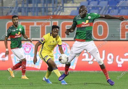 Al-Nassr's Ahmed Musa (L) in action against Al-Ettifaq's Cedric Yambere (R) during the Saudi Professional League soccer match Al-Ettifaq vs Al-Nassr at Prince Mohammed bin Fahd Stadium, Dammam, Saudi Arabia, 24 January 2020.