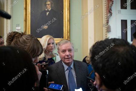 Republican Senator from South Carolina Lindsey Graham (C) speaks with members of the news media before the Senate impeachment trial in the US Capitol in Washington, DC, USA, 24 January 2020. The House impeachment managers will continue to make their case for removing President Trump during their last full day of opening arguments in the impeachment trial of US President Donald J. Trump.
