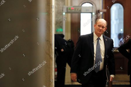 Sen. Christopher A. Coons, D-Del., waits for an elevator as he arrives at the Capitol in Washington during the impeachment trial of President Donald Trump on charges of abuse of power and obstruction of Congress
