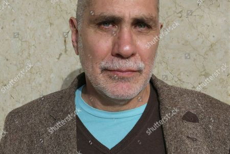 """Stock Image of Writer Guillermo Arriaga poses for a portrait during the Guadalajara International Book Fair in Guadalajara, Mexico. The Mexican writer is the recipient of the 2020 Alfagara Award for his novel """"Salvar el fuego"""