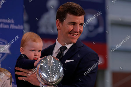 New York Giants NFL football quarterback Eli Manning with his son Charles after announcing his retirement, in East Rutherford, N.J