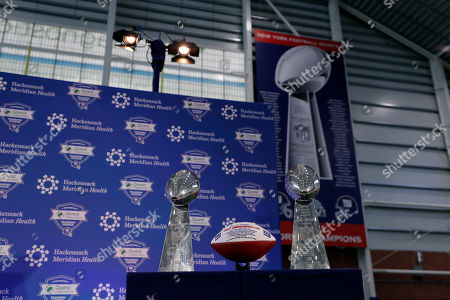 New York Giants NFL football quarterback Eli Manning announces his retirement, in East Rutherford, N.J. Super Bowl XLII and XLVI trophies are seen