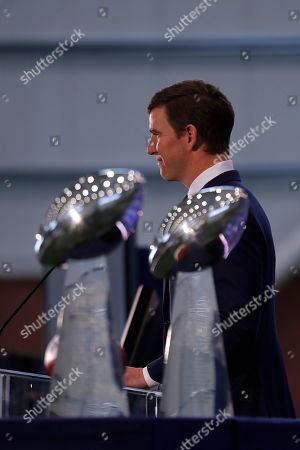New York Giants NFL football quarterback Eli Manning announces his retirement, in East Rutherford, N.J. In the foreground are Super Bowl XLII and XLVI trophies