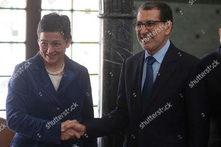 Stock Picture of Arancha Gonzalez, Saad Eddine el-Othmani. Spanish Foreign Minister Arancha Gonzalez, left, shakes hands with Morocco Prime Minister Saad Eddine el-Othmani during her first official visit to Rabat, Morocco