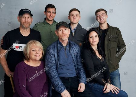 """Steve (Woody) Culleton, Bryson Groh, Zach Boston, Brandon Burke, Michelle John, Ron Howard, Carly Jean Ingersoll. Steve (Woody) Culleton, from left, Bryson Groh, Zach Boston, Brandon Burke, Michelle John, from bottom right, director Ron Howard and Carly Jean Ingersoll pose for a portrait to promote the film """"Rebuilding Paradise"""" at the Music Lodge during the Sundance Film Festival, in Park City, Utah"""