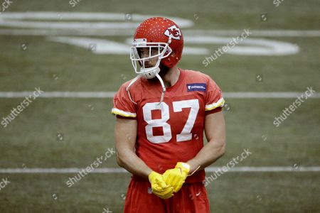 Stock Photo of Kansas City Chiefs tight end Travis Kelce (87) watches a drill during NFL football practice, in Kansas City, Mo. The Chiefs will face the San Francisco 49ers in Super Bowl 54