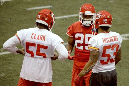 Kansas City Chiefs defensive end Frank Clark (55), running back LeSean McCoy (25) and inside linebacker Anthony Hitchens (53) talk during NFL football practice in Kansas City, Mo. The Chiefs will face the San Francisco 49ers in Super Bowl 54