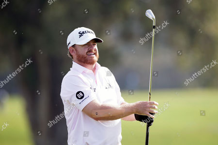 J. B. Holmes watches his shot from the second tee on the Torrey Pines North Course during the second round of The Farmers Insurance golf tournament in San Diego
