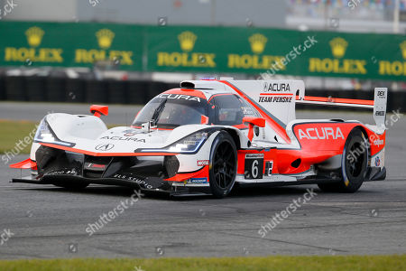 The ACURA Team Penske (6) car driven by Juan Pablo Montoya enters the east horseshoe turn during qualifying for the Rolex 24 hour auto race at the Daytona International Speedway, in Daytona Beach Fla. The Rolex 24 begins Saturday, Jan. 25